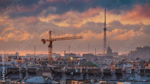 Fotobehang Construction crane and TV Tower over rooftops cityscape of St Petersburg, Russia, epic sunset clouds moving in background. 4K UHD Timelapse.