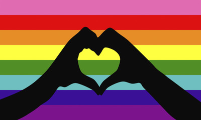 Hands of man showing heart shape with Gay pride flag or LGBT flag. Gay culture symbol.