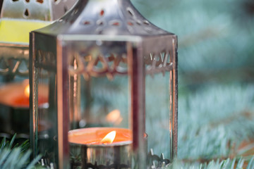 Christmas lantern with candlelight and spruce twig