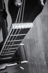 close-up and selective focus shot image of acoustic guitar on a wooden background.grain and noise effect