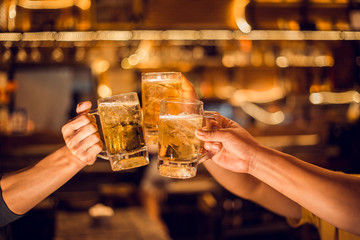 Cheers! Group, Beer mug, Young men brew beer glasses to celebrate their success.