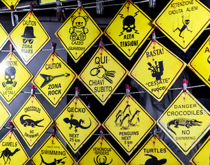 warning signs at a stall of a street market in Salento