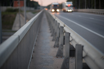 Anodized safety steel barrier on freeway bridge, close up