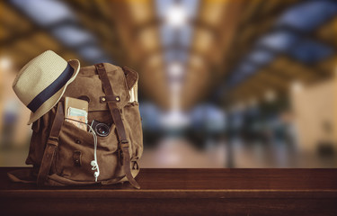 Backpack and hat at the train station . Travel concept. Fototapete