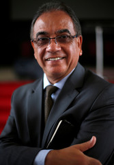 Evangelical Pastor and Secretary of Presidency of the Brazilian government, Ronaldo Fonseca, poses for a picture before a mass in the Assemblies of God evangelical Church in Brasilia