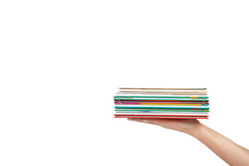 Different colorfull books in stack with hand isolated on white background, copy space template