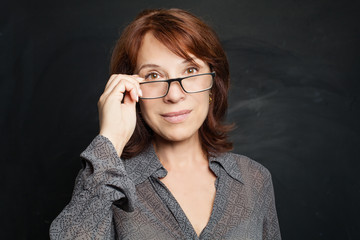 Mature woman in glasses, portrait