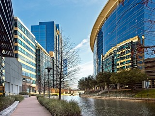 Waterway with Glass Buildings in The Woodlands TX Wall mural