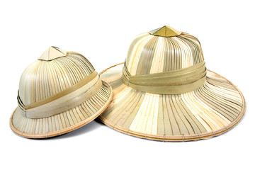 It is two palm leaves hat isolated on white background.Dried palm leaf hat