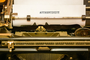authenticity - written with old typewriter on white paper