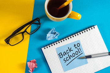 September 1st - Back to school concept on a blue background with teacher glasses and morning coffee
