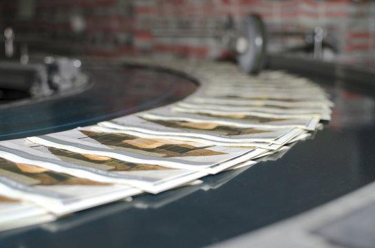 Printing machine magazine production line, selective focus