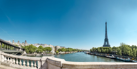 Panorama of Eiffel Tower with Bir Hakeim bridge and The Seine River in Paris, France