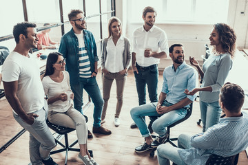 Group of Young Business People on Break in Office