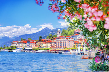 Lake Como, town Bellagio, Italy. Fascinating scenery of coastal town in famous and popular luxury summer resort - lake Como. Boat ferry in the distance.