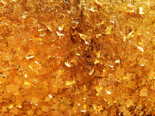 Texture of the gold leaf, Gold background, Picture from Buddha image Back