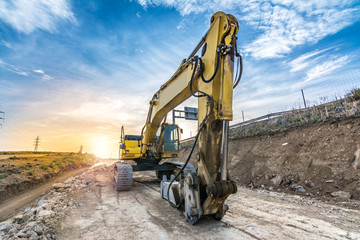 Hydraulic hammer working on road expansion works