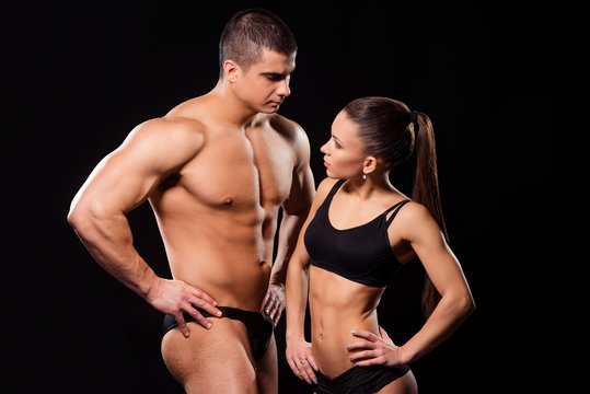 Muscular bodybuilding couple in underwear.