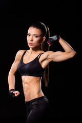 Young female flexing bicep.
