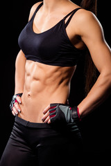 Fit abs of young girl.