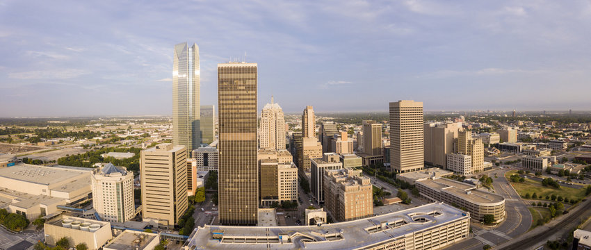 Aerial panorama of downtown Oklahoma City at dawn.