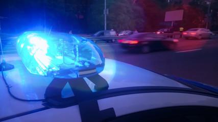 Closeup blinking strobe lights on police car, blue lightbar, emergency situation Fotomurales
