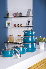 close up view of nice cookware set with some vegetables on kitche