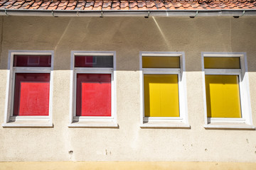 Four colorful windows on a building