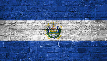 Flag of El Salvador over an old brick wall background, surface