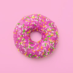 Purple donut in glaze on a pink background. Great fresh tasty purple donut drizzled with glaze