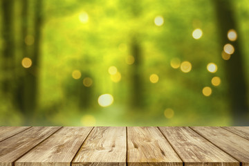 wooden table with blurred summer forest background