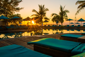 Sunset at the beach of Gili Trawangan with colorful sky and sunbeds, the paradise island, Gili, Bali Lombok in Indonesia