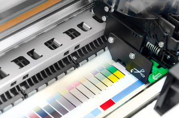 Working industrial large format UV inkjet printer ploter for printing on big sheets of plastic or billboards isolated over white