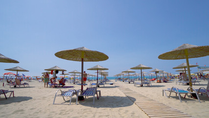 beach umbrellas and sunbeds on summer vacation resort