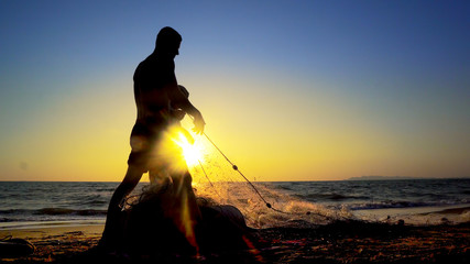 Silhouette Fishermen using fishing nets, fishing with nets in the morning sunrise, cinematic