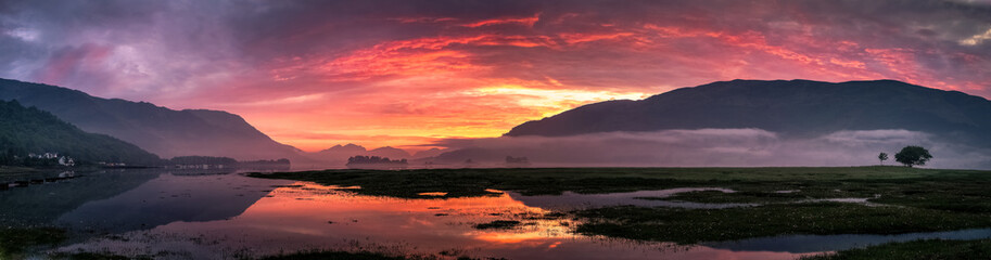 Beautiful colorful sunset over Loch Leven, Glencoe village, Scotland, UK