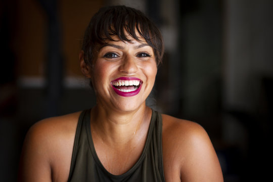 Happy Latina Woman Smiling, Fitness Model at the Gym