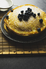 Sweet pancakes with honey and blueberry.