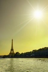 The Eiffel Tower and river Seine at sunrise in Paris, France, vertical silhouette, travel background