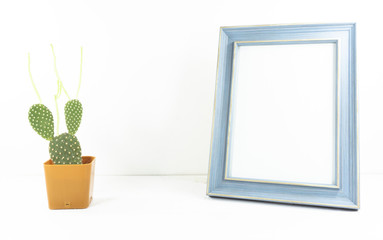 ..Photo wood frame vintage and  Cactus in pot brown style on white background,copy space. .
