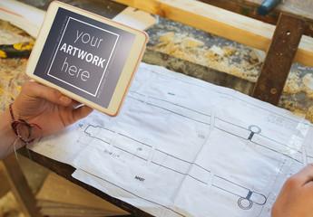 Tablet near Blueprints Mockup