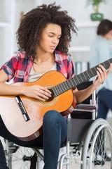 disabled girl playing guitar