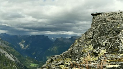 Wall Mural - 4K Timelapse of Geiranger Scenic Vista Point and Tourists Visiting the Place.