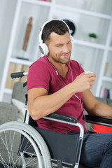 handsome musician in wheelchair having a break