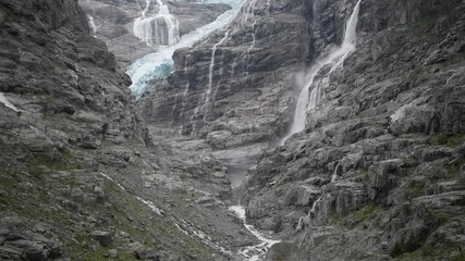 Fotomurales - Scenic Kjenndal Glacier with Many Waterfalls During Summer Day.