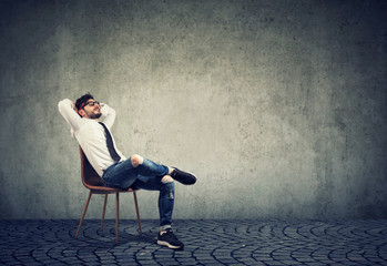 Man sitting on chair in relaxation