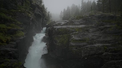 Wall Mural - Norwegian Wilderness and the River. Scenic Landscape with Waterfalls