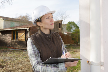 a young engineer woman is inspecting a construction site