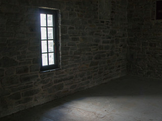 Inside metal stairwell with stone walls, no people, interior
