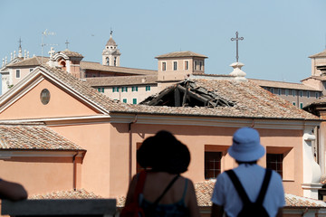 People look at the collapsed roof of the San Giuseppe dei Falegnami church in Rome